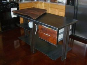 Our custom kitchen island with a large butchers block.
