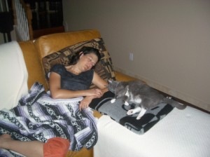 2009 – Sleeping on the couch with our cat.  Typical.